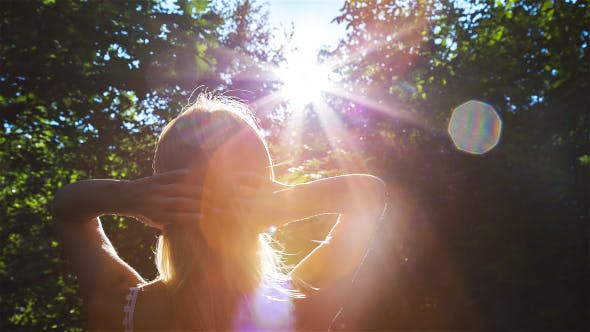 Thumbnail for Beautiful Blonde Girl Playing with the Sun in City Park 2