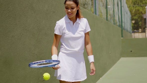 Thumbnail for Pretty Athlete Practicing With Ball And Racket