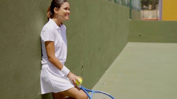 Thumbnail for Smiling Young Woman Holding Racket On Tennis Court