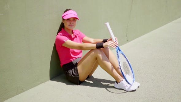 Thumbnail for Attractive Female Tennis Player Sitting In The Sun