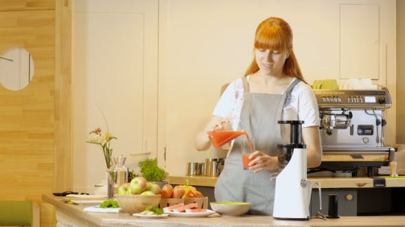 Thumbnail for Young Woman Slicing a Ripe Watermelon In Background. Healthy Eco Food Rich In Vitamins. Popular