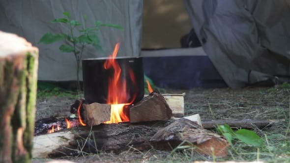 Thumbnail for Cooking Food Over a Campfire At The Tourist Pot