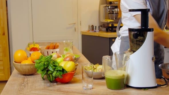 Thumbnail for Green Smoothie Woman Making Vegetable Smoothies With Blender.