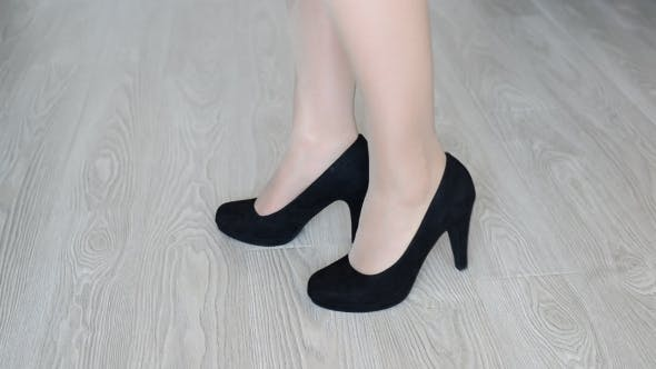 Thumbnail for Woman Takes Off Down a Black High-heeled Shoes