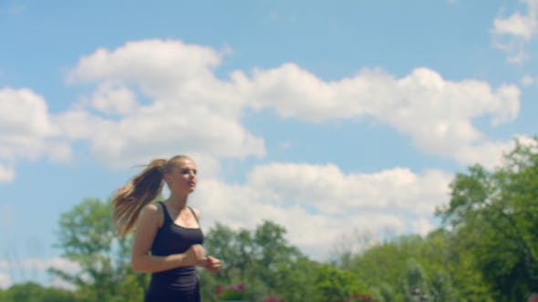 Thumbnail for Fitness Woman Running In. Girl Runs On Sky Background