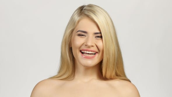 Thumbnail for Blonde Woman Smiling Facing Forwards. White
