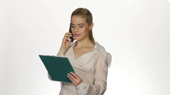 Thumbnail for Business Woman Talking On The Phone And Makes Notes. White