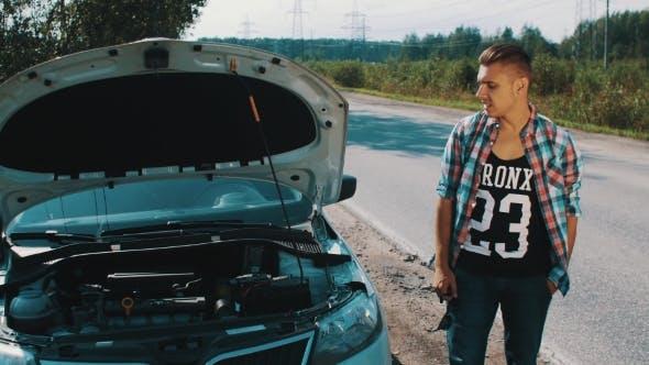 Thumbnail for Nervous Boy Stay At Broken Car At Road. Kick Car. Waiting For Help. Thumb Up.