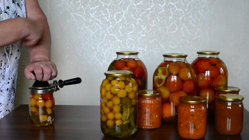 Mature Housewife Closes Banks Of Homemade Preserves
