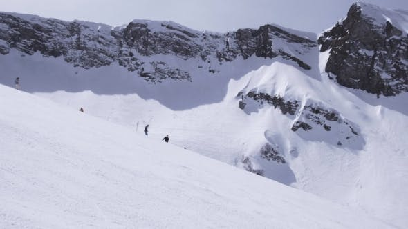 Thumbnail for Landscape Of Snowy Mountains In Sunny Day. Ski Resort. Snowboarders On Slope.