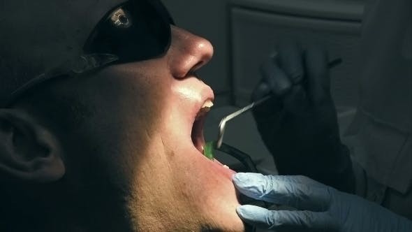 Cover Image for Man Gets Dental Medical Examination And Treatment