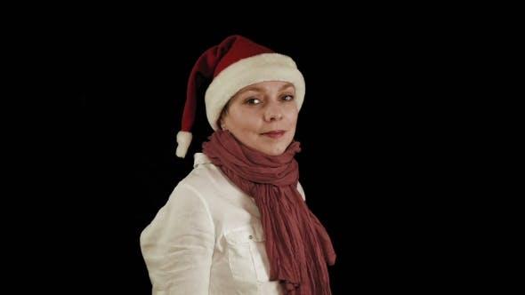 Thumbnail for Pretty Girl In Red Christmas Santa Hat Smiles
