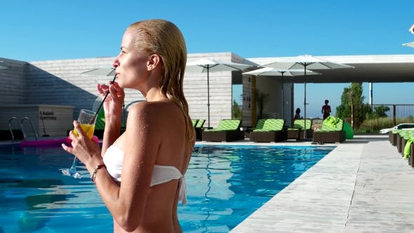 Thumbnail for Portrait Girl Drinking a Cocktail By The Pool.