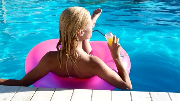 Thumbnail for Sexy Girl On Summer Vacation In The Pool.