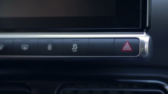 Thumbnail for Woman Pressing Emergency Button On Car Dashboard