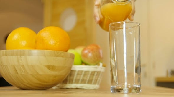 Thumbnail for Orange Juice Pouring Into Glass