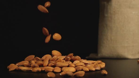 Thumbnail for Almonds Fall In A Pile On A Table