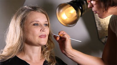Makeup Artist Applying Make Up on Lips