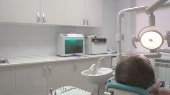 Thumbnail for Dentist Treats The Patient's Tooth