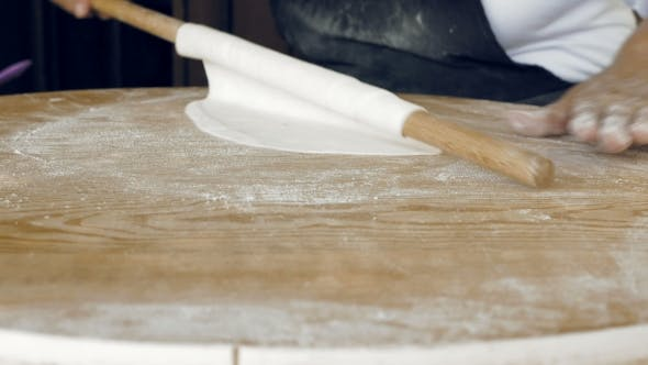 Thumbnail for Rolling The Pastry Dough On a Flat Wooden Surface