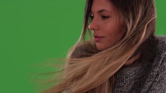 Thumbnail for Close up of beautiful millennial woman with hair blowing in wind on greenscreen