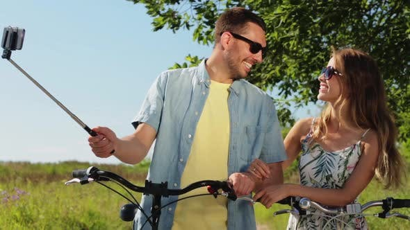 Thumbnail for Couple with Bicycle and Smartphone Selfie Stick