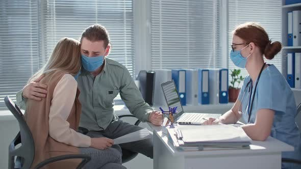 Man and Wife in Medical Masks are Upset and Discouraged Due to Poor Analysis During Consultation