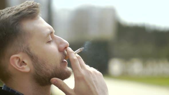 Thumbnail for Man Enjoying Smoke Break