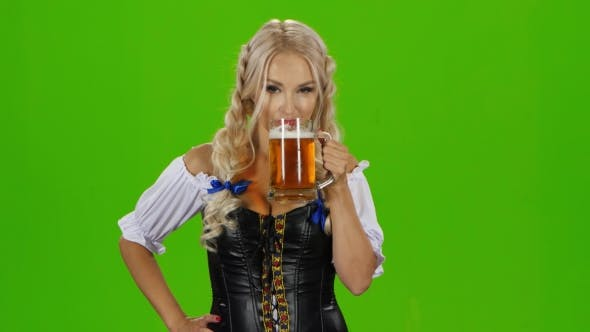 Thumbnail for Bavarian Woman Drinking a Beer Glass Showing Thumbs Up And Winking. Green Screen