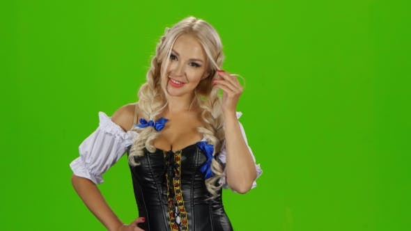 Thumbnail for Bavarian Sexy Woman Playing With Her Hair Curl. Green Screen
