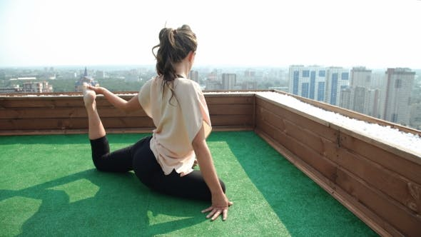Thumbnail for Beautiful Woman Doing a Yoga Exercise On He Rooftop Of a Skyscraper. 20S.