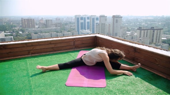 Thumbnail for Yoga And Meditation In a Modern City. Young Woman Doing Yoga On The Roof.