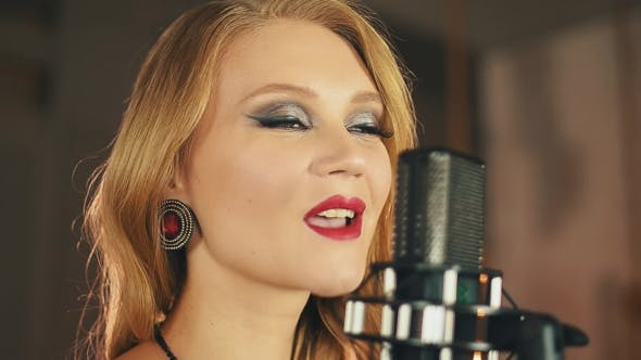 Thumbnail for Vocalist With Red Lips Make Up Perform At Microphone. Retro Style