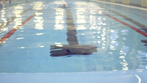 Thumbnail for Female Swimmer Training In Swimming Pool