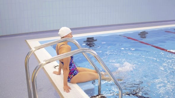 Thumbnail for Woman Sitting Near Swimming Pool Stairs