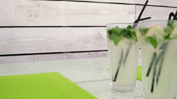 Thumbnail for Four Mojito Cocktail Standing On The Table