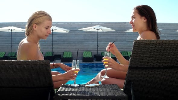 Thumbnail for Two Beautiful Girls Drinking Cocktails Poolside