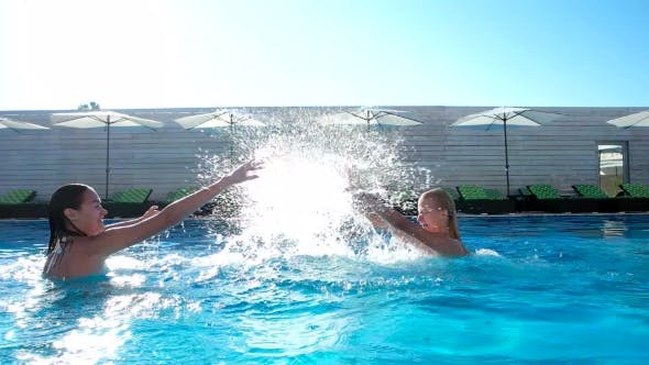 Thumbnail for Two Girls Squirting Water In The Pool