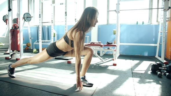 Thumbnail for Young Woman With Sports Body Stretching