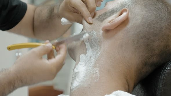 Thumbnail for Barber Is Shaving His Client In Old Fashion Manner