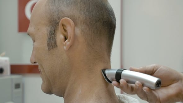 Thumbnail for Barber Is Shaving His Client's Neck With Shearer