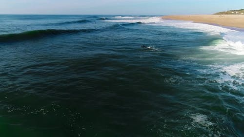 Aerial Drone Footage of Coastal Waves on Sunny Day