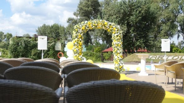 Thumbnail for Arch With Fresh Yellow And White Flowers For Wedding Ceremony