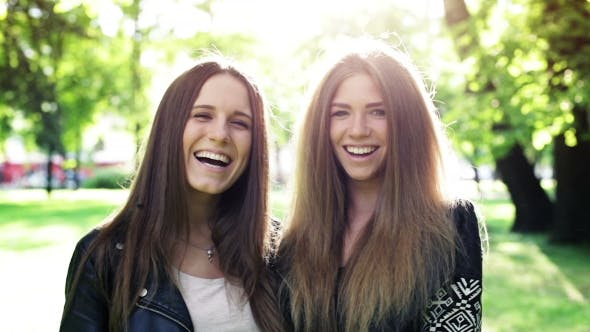 Cover Image for Two Laughing Girls In The City Park