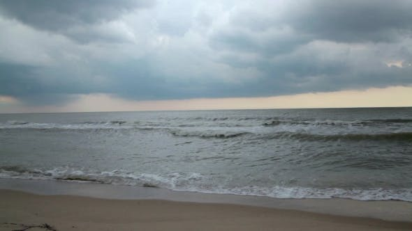 Cover Image for Sunset On The Beach Cloudy Weather. Storm