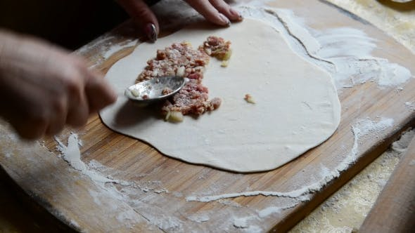 Thumbnail for Housewife Making Chebureks From Dough And Sausage Meat