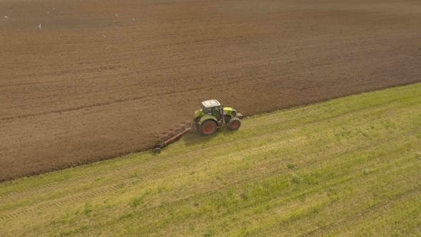 Thumbnail for Tractor Plowing a field.Aerial Video.