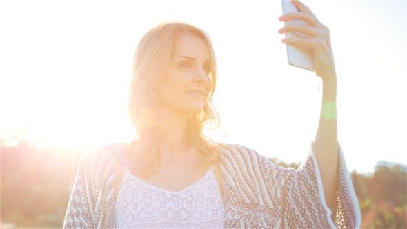 Thumbnail for Beautiful Girl Making Selfie Enjoying the Sun in City Park 4