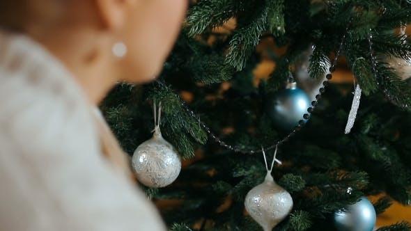 Thumbnail for Woman Preparing Christmas Tree