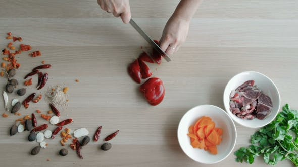 Thumbnail for Female Hands Cutting Pepper, Making Salad. Top View Chief Cutting Vegetables